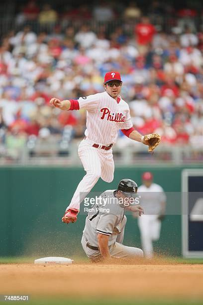 PHILADELPHIA JUNE 13 Chase Utley of the Philadelphia Phillies turns a double play during the game against the Chicago White Sox at Citizens Bank Park...