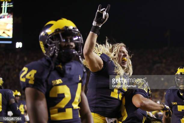 Chase Winovich of the Michigan Wolverines celebrates a touchdown by Lavert Hill in the second half against the Wisconsin Badgers on October 13 2018...