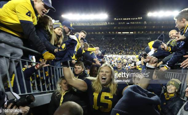 Chase Winovich of the Michigan Wolverines celebrates a win over Penn State Nittany Lions at Michigan Stadium on November 3 2018 in Ann Arbor Michigan...