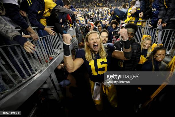 Chase Winovich of the Michigan Wolverines leaves the field celebrating a 3813 victory over the Wisconsin Badgers on October 13 2018 at Michigan...