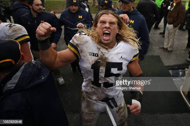 Chase Winovich of the Michigan Wolverines leaves the field after a 217 win over the Michigan State Spartans at Spartan Stadium on October 20 2018 in...