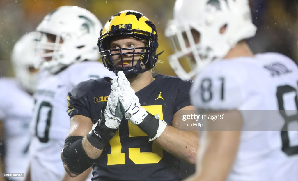 Chase Winovich #15 of the Michigan Wolverines signals the sidelines during the fourth quarter of the game against the Michigan State Spartans at Michigan Stadium on October 7, 2017 in Ann Arbor, Michigan. Michigan State defeated Michigan 14-10.