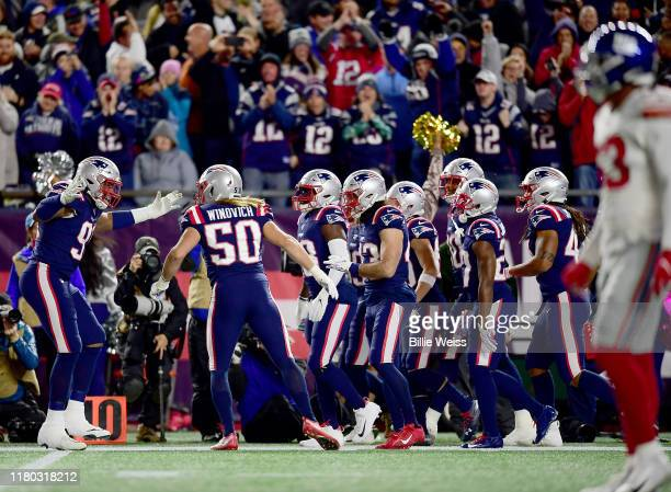 Chase Winovich of the New England Patriots celebrates after scoring a touchdown off of a recovered blocked punt against the New York Giants during...