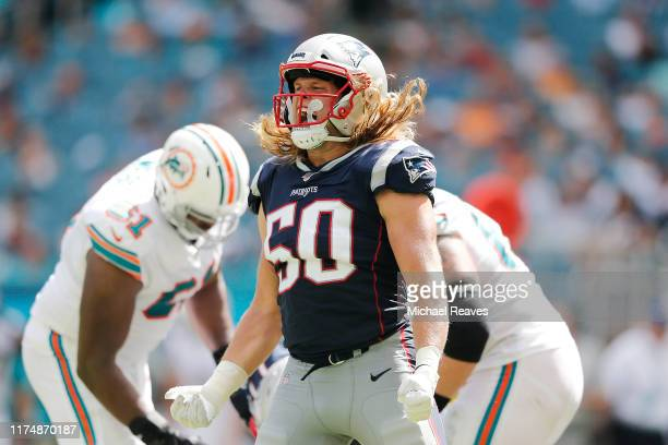 Chase Winovich of the New England Patriots reacts after a sack against the Miami Dolphins during the third quarter at Hard Rock Stadium on September...