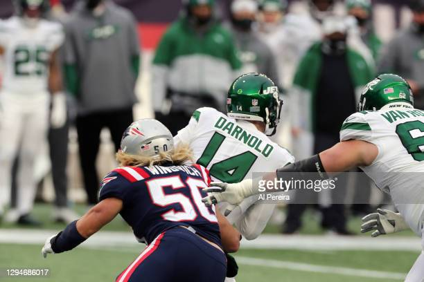 Chase Winovich of the New England Patriots sacks Sam Darnold of the New York Jets at Gillette Stadium on January 3, 2021 in Foxborough, Massachusetts.