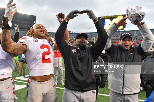 Chase Young Defensive Coach Al Washington and Head Football Coach Ryan Day of the Ohio State Buckeyes celebrate after a college football game against...