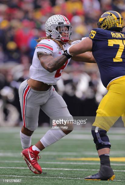 Chase Young of the Ohio State Buckeyes battles Jon Runyan of the Michigan Wolverines during the first quarter of the game at Michigan Stadium on...