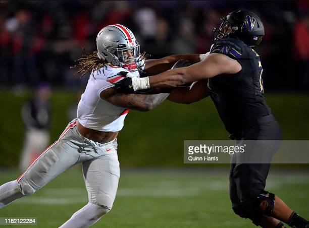 Chase Young of the Ohio State Buckeyes battles Rashawn Slater of the Northwestern Wildcats in the third quarter at Ryan Field on October 18, 2019 in...