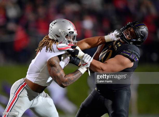 Chase Young of the Ohio State Buckeyes battles Rashawn Slater of the Northwestern Wildcats in the third quarter at Ryan Field on October 18 2019 in...
