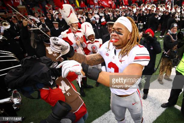Chase Young of the Ohio State Buckeyes celebrates a victory over the Michigan Wolverines by directing the Ohio State Buckeyes Marching Band at...