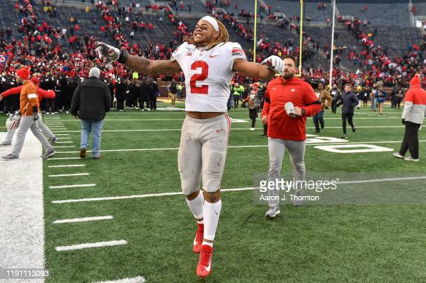 Chase Young of the Ohio State Buckeyes celebrates after a college football game against the Michigan Wolverines at Michigan Stadium on November 30...