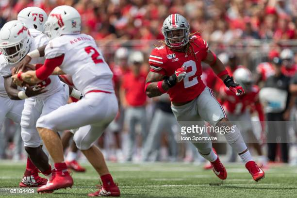 Chase Young of the Ohio State Buckeyes chases down Chris Robison of the Florida Atlantic Owls during game action between the Ohio State Buckeyes and...