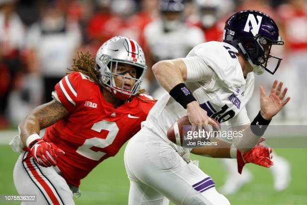 Chase Young of the Ohio State Buckeyes chases down Clayton Thorson of the Northwestern Wildcats in in the third quarter at Lucas Oil Stadium on...
