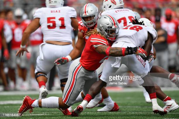 Chase Young of the Ohio State Buckeyes drops James Charles of the Florida Atlantic Owls for a loss in the second quarter at Ohio Stadium on August 31...