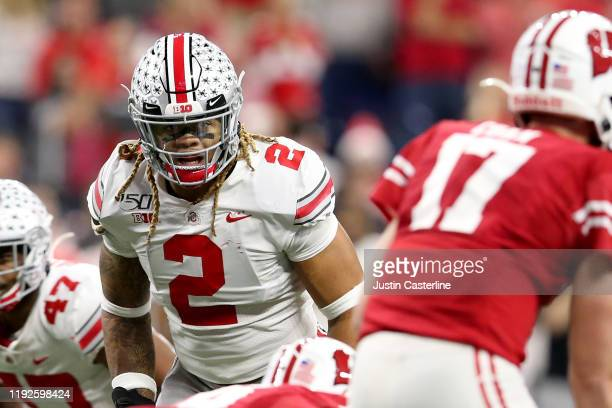 Chase Young of the Ohio State Buckeyes eyes the quarterback in the Big Ten Championship game against the Wisconsin Badgers during the second quarter...