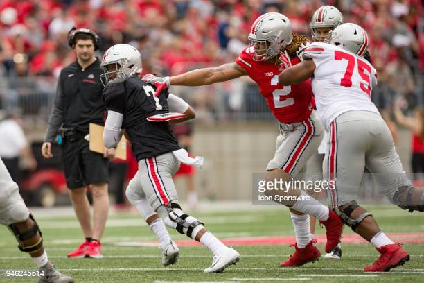 Chase Young of the Ohio State Buckeyes gets his hands on Dwayne Haskins of the Ohio State Buckeyes for a tackle during the Ohio State Life Sports...