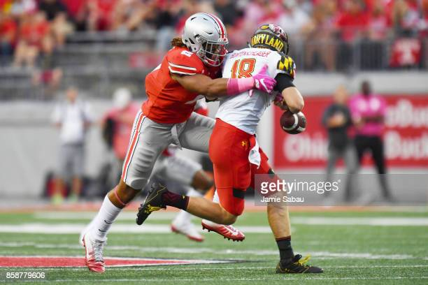 Chase Young of the Ohio State Buckeyes hits quarterback Max Bortenschlager of the Maryland Terrapins in the backfield causing a fumble in the third...