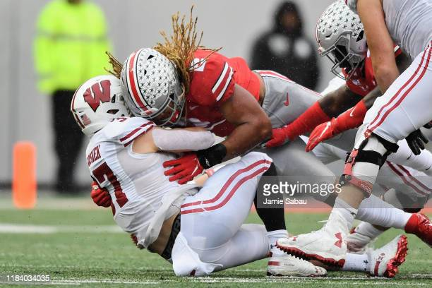 Chase Young of the Ohio State Buckeyes makes a tackle against the Wisconsin Badgers at Ohio Stadium on October 26 2019 in Columbus Ohio