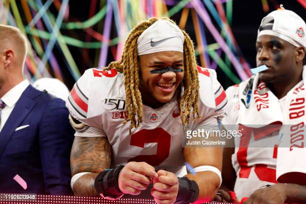 Chase Young of the Ohio State Buckeyes on the stage after winning the Big Ten Championship game over the Wisconsin Badgers at Lucas Oil Stadium on...