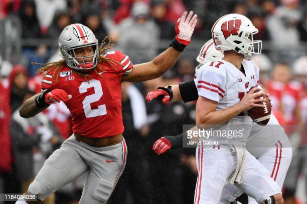 Chase Young of the Ohio State Buckeyes pressures the quarterback against the Wisconsin Badgers at Ohio Stadium on October 26 2019 in Columbus Ohio