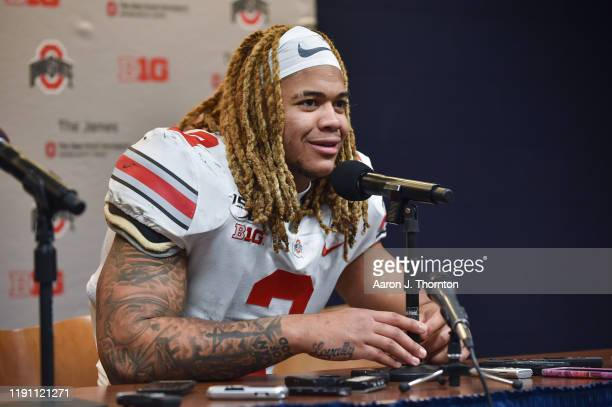Chase Young of the Ohio State Buckeyes speaks during the post game press conference after a college football game against the Michigan Wolverines at...