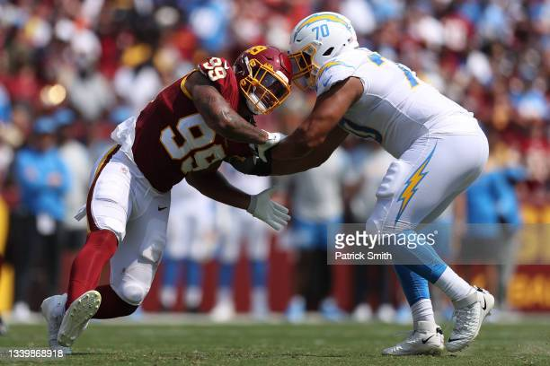 Chase Young of the Washington Football Team rushes the quarterback against Rashawn Slater of the Los Angeles Chargers during the second quarter at...