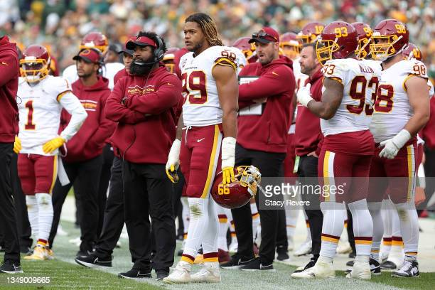 Chase Young of the Washington Football Team stands on the sideline during a game against the Green Bay Packers at Lambeau Field on October 24, 2021...