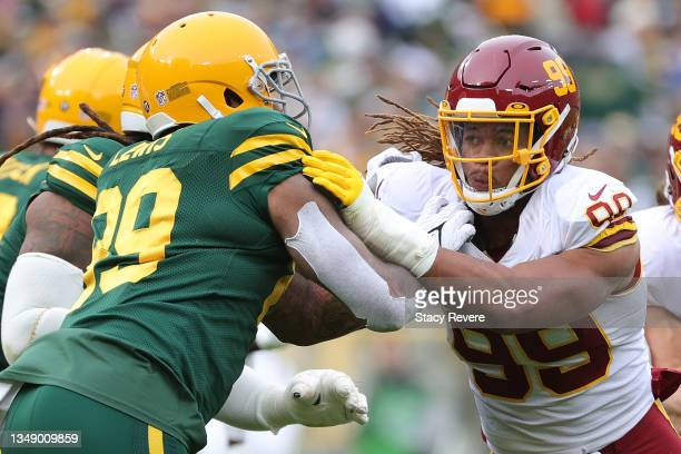 Chase Young of the Washington Football Team works against Marcedes Lewis of the Green Bay Packers during a game at Lambeau Field on October 24, 2021...