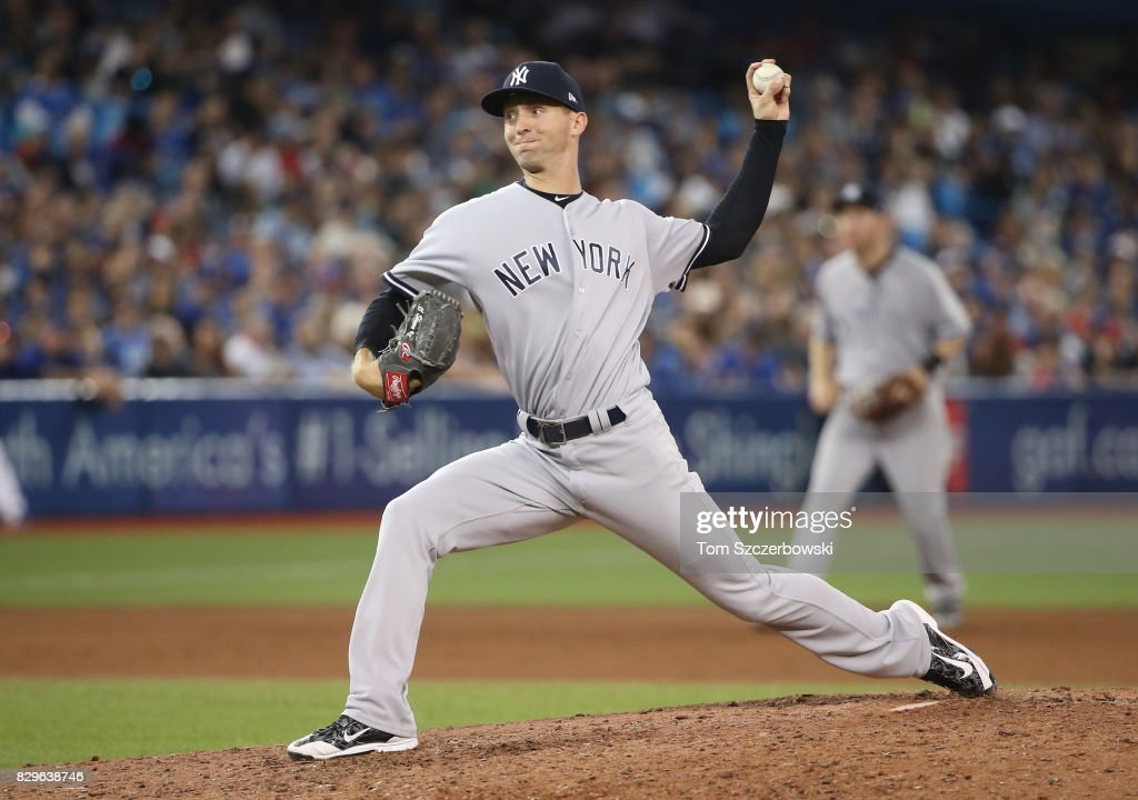 Chasen Shreve #45 of the New York Yankees delivers a pitch in the seventh inning during MLB game action against the Toronto Blue Jays at Rogers Centre on August 10, 2017 in Toronto, Canada.