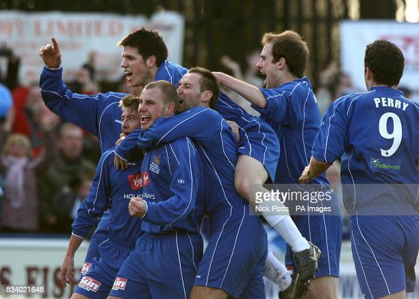 Chasetown celebrate the opening goal of the game an own goal scored by Cardiff City's Kevin McNaughton
