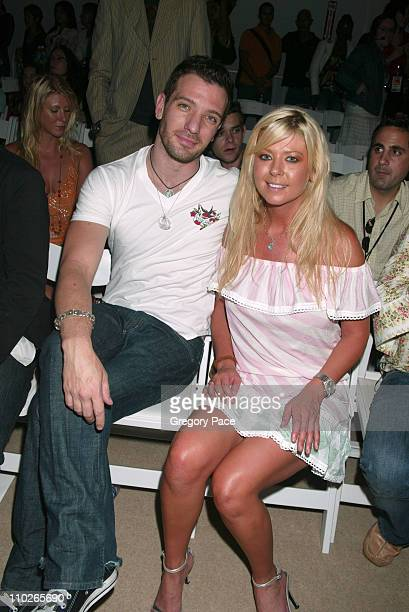 JC Chasez and Tara Reid during Olympus Fashion Week Spring 2006 Custo Barcelona Front Row at Bryant Park in New York City New York United States