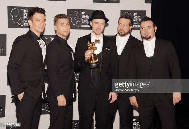 JC Chasez Lance Bass Justin Timberlake Joey Fatone and Chris Kirkpatrick of N'Sync attend the 2013 MTV Video Music Awards at the Barclays Center on...