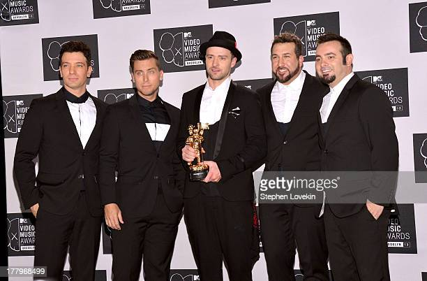 JC Chasez Lance Bass Justin Timberlake Joey Fatone and Chris Kirkpatrick of N'Sync pose with the Michael Jackson Video Vanguard Award at the 2013 MTV...