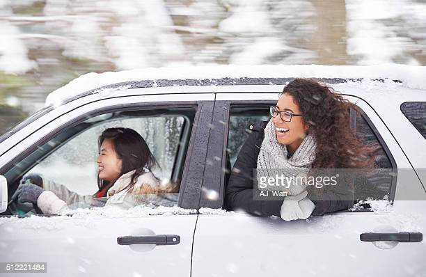 chasing a wintery adventure - driving in snow stock photos and pictures