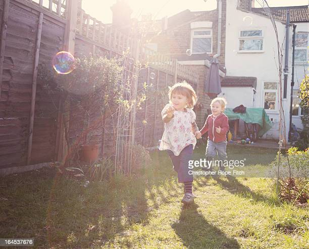 chasing bubbles - chasing stock pictures, royalty-free photos & images