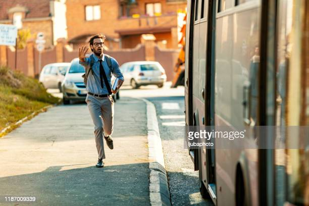 chasing bus - urgency stock pictures, royalty-free photos & images