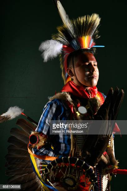 Chasing Hawk, a Lakota Sioux from the Rosebud reservation in South Dakota, poses for a portrait during the 43rd annual Denver March Powwow at the...