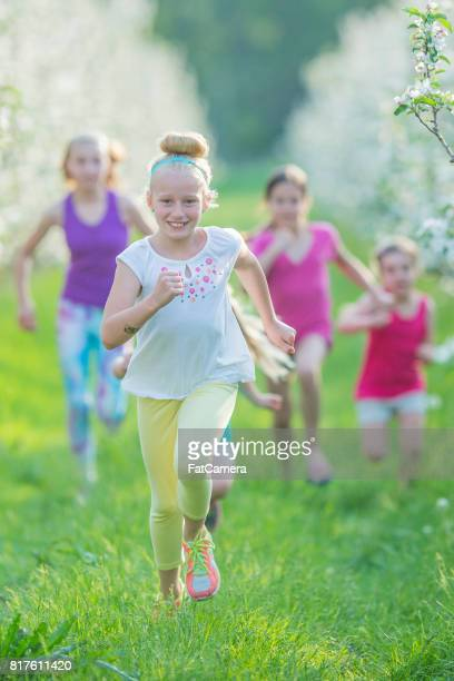 chasing - kids playing tag stock photos and pictures