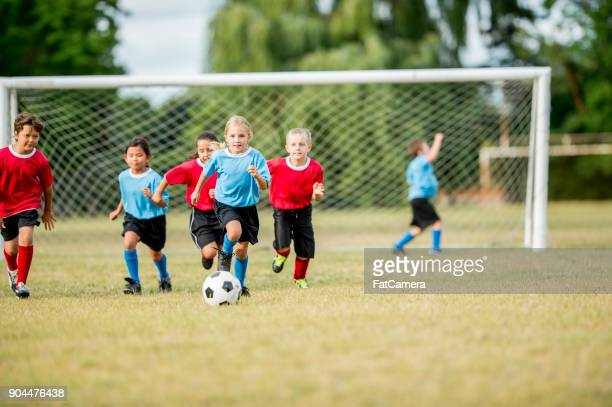 chasing the ball - soccer stock pictures, royalty-free photos & images