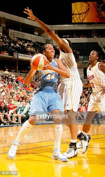 Chasity Melvin of the Chicago Sky looks to pass the ball against Tammy SuttonBrown of the Indiana Fever at Conseco Fieldhouse on July 12 2008 in...