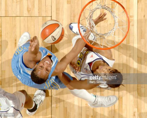 Chasity Melvin of the Chicago Sky shoots against Tangela Smith of the Phoenix Mercury on June 20 at U.S. Airways Center in Phoenix, Arizona. NOTE TO...