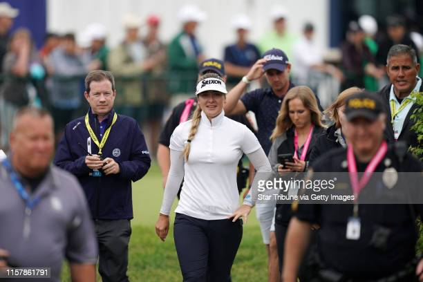Hannah Green smiled as she was led from the clubhouse to the eighteenth hole green for the trophy presentation ceremony Sunday after winning the KPMG...