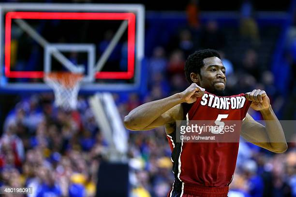 Chasson Randle of the Stanford Cardinal celebrates defeating the Kansas Jayhawks 60 to 57 during the third round of the 2014 NCAA Men's Basketball...