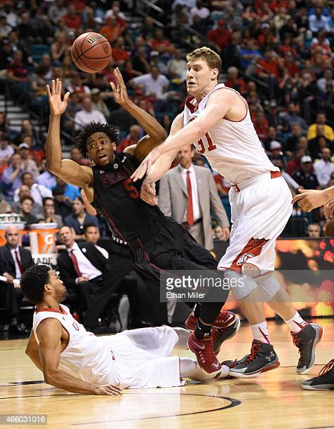 Chasson Randle of the Stanford Cardinal is fouled by Isaiah Wright of the Utah Utes as Dallin Bachynski of the Utes defends during a quarterfinal...