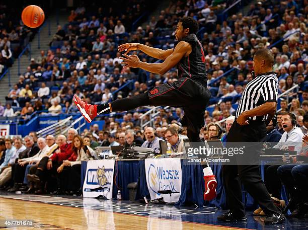 Chasson Randle of the Stanford Cardinal keeps a ball in bounds in the first half against the Connecticut Huskies during the game at XL Center on...