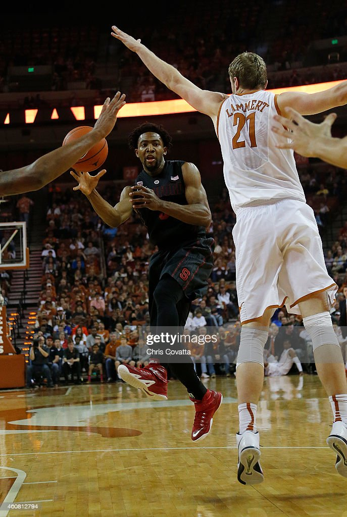Chasson Randle #5 of the Stanford Cardinal passes around Connor Lammert #21 of the Texas Longhorns at the Frank Erwin Center on December 23, 2014 in Austin, Texas.