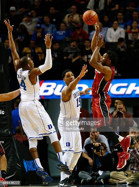 Chasson Randle of the Stanford Cardinal takes a shot as Rasheed Sulaimon and Jahlil Okafor of the Duke Blue Devils guard him during the second half...