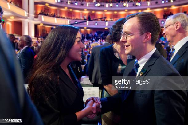 Chasten Buttigieg husband of 2020 Democratic presidential candidate Pete Buttigieg right shakes hands with an attendee ahead of the Democratic...
