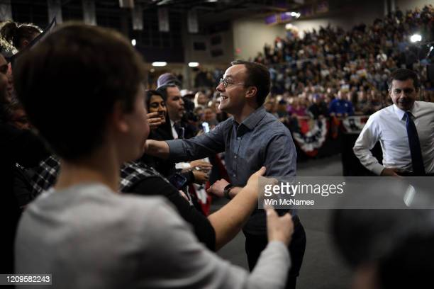 Chasten Buttigieg husband of Democratic presidential candidate former South Bend Indiana Mayor Pete Buttigieg greets supporters after speaking at a...