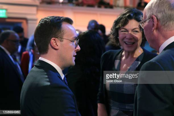 Chasten Buttigieg the husband of Democratic presidential candidate former South Bend Indiana Mayor Pete Buttigieg chats with guests before the start...